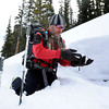 "Scott Toepfer checks the texture of the snow after digging a snow pit to observe current snow conditions on Wednesday, Feb. 22, on Wheeler Trail in Breckenridge. Toepfer works for the Colorado Avalanche Information Center and was heading to Francie's Cabin to check conditions above tree line. For more photos and video of the avalanche forecasting go to  <a href=""http://www.dailycamera.com"">http://www.dailycamera.com</a><br /> Jeremy Papasso/ Camera"