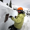 Scott Toepfer, Avalanche Forecaster with Colorado Avalanche Information Center, flattens the edges of the snow for observation during a day analyzing the snowpack in the Crystal Creek Drainage area above Breckenridge Colorado on February 22, 2012. <br /> Photo by Jenn Fields / The Camera / Boulder