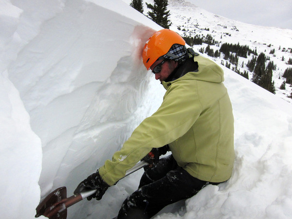 Scott Toepfer, Avalanche Forecaster with Colorado Avalanche Information Center, digs a snow pit during a day analyzing the snowpack in the Crystal Creek Drainage area above Breckenridge Colorado on February 22, 2012. <br /> Photo by Jenn Fields / The Camera / Boulder