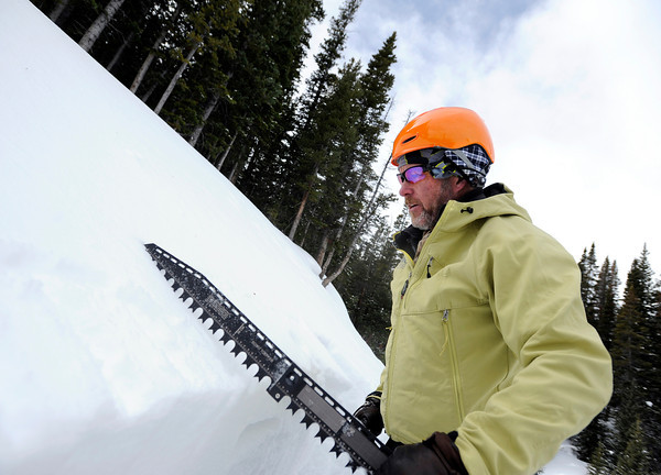 "Scott Toepfer uses a saw to cut a block of snowpack out of a snow pit to observe current snow conditions on Wednesday, Feb. 22, on Wheeler Trail in Breckenridge. Toepfer works for the Colorado Avalanche Information Center and was heading to Francie's Cabin to check conditions above tree line. For more photos and video of the avalanche forecasting go to  <a href=""http://www.dailycamera.com"">http://www.dailycamera.com</a><br /> Jeremy Papasso/ Camera"