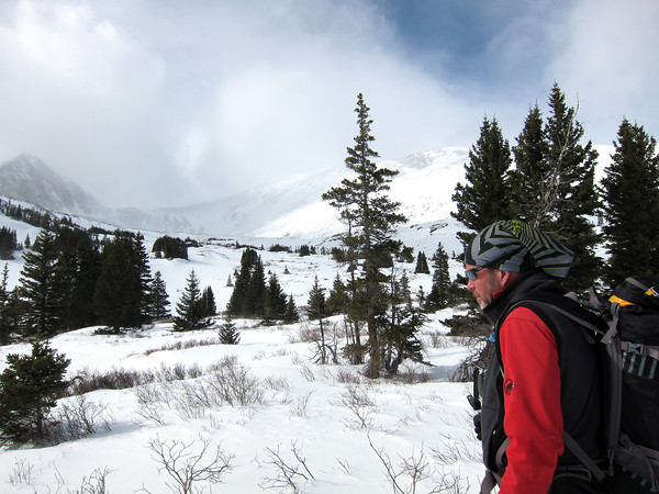 Scott Toepfer, Avalanche Forecaster with Colorado Avalanche Information Center, looks toward an area popular with backcountry skiers during a day analyzing the snowpack in the Crystal Creek Drainage area above Breckenridge Colorado on February 22, 2012. <br /> Photo by Jenn Fields / The Camera / Boulder