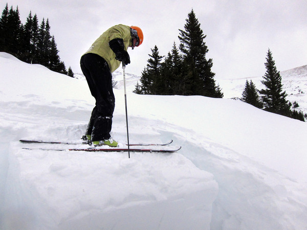 Scott Toepfer, Avalanche Forecaster with Colorado Avalanche Information Center, triggers a slide of the top layer of snow during a day analyzing the snowpack in the Crystal Creek Drainage area above Breckenridge Colorado on February 22, 2012. <br /> Photo by Jenn Fields / The Camera / Boulder