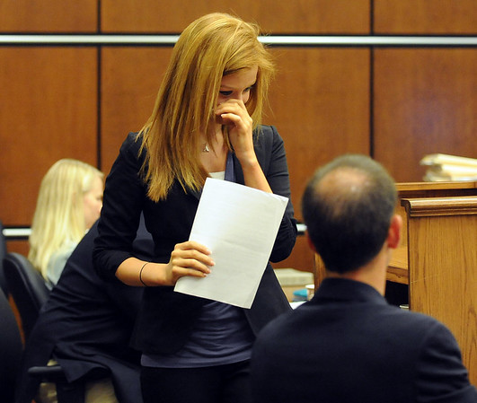 "Abby Toll wipes a tear after her  statement at her sentencing hearing.<br /> Abby Toll  was  taken into custody after sentencing. She will spend 30 days in jail for and 3 years probation for  felony animal cruelty. For more photos, go to  <a href=""http://www.dailycamera.com"">http://www.dailycamera.com</a>.<br /> Cliff Grassmick / July 9, 2010"