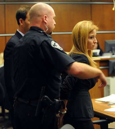 "Abby Toll  was  taken into custody after sentencing. She will spend 30 days in jail for and 3 years probation for  felony animal cruelty. For more photos, go to  <a href=""http://www.dailycamera.com"">http://www.dailycamera.com</a>.<br />  Cliff Grassmick / July 9, 2010"