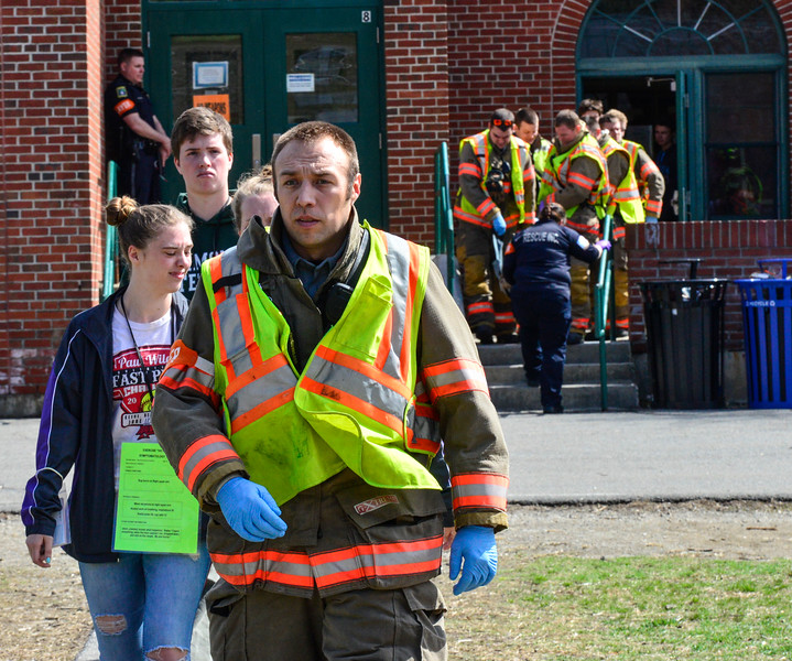 KRISTOPHER RADDER - BRATTLEBORO REFORMER<br /> Actors with minor injuries walk to a nearby school bus while others are transported out on a MageMover to various ambulances that were staged at Oak Grove Elementary School during an active shooter training on Thursday, April 20, 2017.