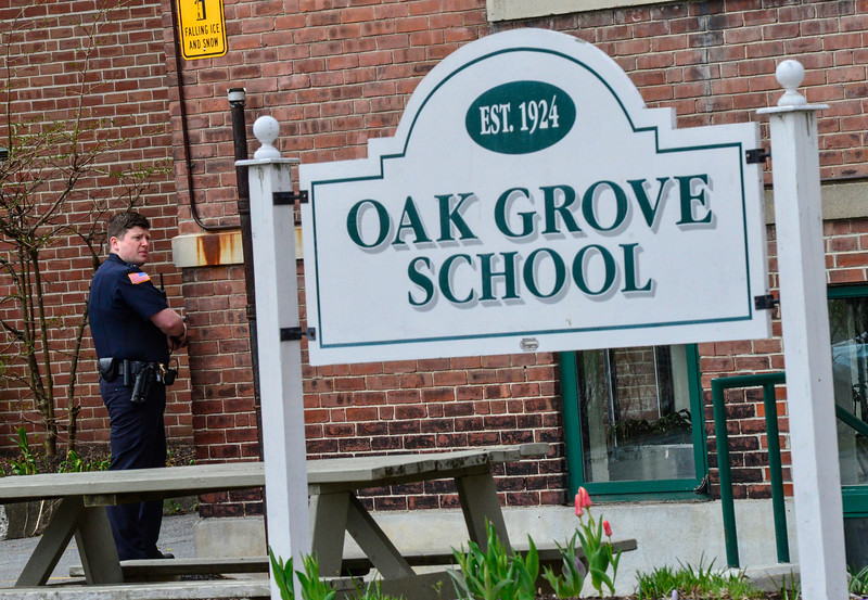 KRISTOPHER RADDER - BRATTLEBORO REFORMER<br /> Brattleboro Police detective Ryan Washburn stages outside of the Oak Grove Elementary School during an active shooter training on Thursday, April 20, 2017.