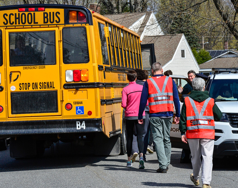 KRISTOPHER RADDER - BRATTLEBORO REFORMER<br /> Actors line up to board a school bus at Oak Grove Elementary School during an active shooter training on Thursday, April 20, 2017.
