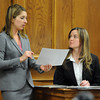 "Defense attorney, Kathryn Herold, left, shows crime scene photos to CBI investigator, Amy Miller.<br /> The  second day of the murder trial of Adam Raszynski continues in Boulder County Court. For more photos of the trial, go to  <a href=""http://www.dailycamera.com"">http://www.dailycamera.com</a>.<br /> March 15, 2012 / Cliff Grassmick"