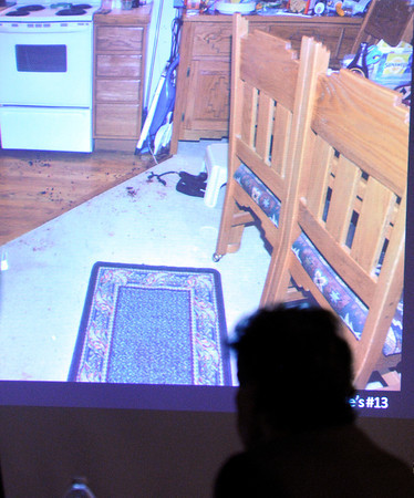 "A photograph taken of the crime scene used as evidence on Thursday, March 15, during the second day of the Adam Raszynski murder trial at the Boulder County Justice Center in Boulder. Raszinski is on trial for the murder of his mother Rita Redford. For more photos of the trial go to  <a href=""http://www.dailycamera.com"">http://www.dailycamera.com</a><br /> Jeremy Papasso/ Camera"