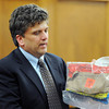 "Prosecuting attorney, Ryan Brackley, holds evidence during the trial on Thursday.<br /> The  second day of the murder trial of Adam Raszynski continued on Thursday. For more photos of the trial,  <a href=""http://www.dailycamera.com"">http://www.dailycamera.com</a>.<br /> Cliff Grassmick / March 15, 2012"