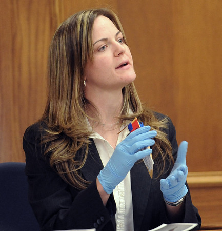 "CBI investigator, Amy Miller, holds the bullet fragment evidence Thursday afternoon.<br /> The  second day of the murder trial of Adam Raszynski continues in Boulder County Court. For more photos of the trial, go to  <a href=""http://www.dailycamera.com"">http://www.dailycamera.com</a>.<br /> March 15, 2012 / Cliff Grassmick"