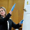 "Amy Miller, of the Colorado Bureau of Investigations, shows the jury the door that the body of Rita Redford was found next to on Thursday, March 15, during the second day of the Adam Raszynski murder trial at the Boulder County Justice Center in Boulder. Raszinski is on trial for the murder of his mother Rita Redford. For more photos of the trial go to  <a href=""http://www.dailycamera.com"">http://www.dailycamera.com</a><br /> Jeremy Papasso/ Camera"