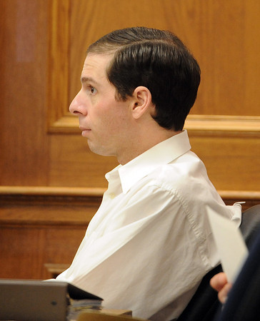 """Adam Raszynski listens to CBI investigator, Amy Miller, thursday afternoon.<br /> The  second day of the murder trial of Adam Raszynski continues in Boulder County Court. For more photos of the trial, go to  <a href=""""http://www.dailycamera.com"""">http://www.dailycamera.com</a>.<br /> March 15, 2012 / Cliff Grassmick"""