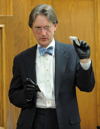"Alex Rugh, a CBI forensics expert, compares the size of the gun barrel with a bullet  mark in the wood.<br /> The  second day of the murder trial of Adam Raszynski continued on Thursday. For more photos of the trial,  <a href=""http://www.dailycamera.com"">http://www.dailycamera.com</a>.<br /> Cliff Grassmick / March 15, 2012"