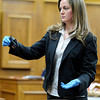 "Amy Miller, of the Colorado Bureau of Investigations, shows the jury the gun allegedly used by Rita Redford on the night of her death on Thursday, March 15, during the second day of the Adam Raszynski murder trial at the Boulder County Justice Center in Boulder. Raszinski is on trial for the murder of his mother Rita Redford. For more photos of the trial go to  <a href=""http://www.dailycamera.com"">http://www.dailycamera.com</a><br /> Jeremy Papasso/ Camera"