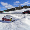 KRISTOPHER RADDER - BRATTLEBORO REFORMER<br /> A car stuck in the medium of I-91 near exit 2 on/off ramps on Wednesday, March 15, 2017 after Winter Storm Stella.