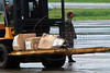 Boxes labeled in Portuguese 'Bag for corpse' are transported by Brazilian Air Force officers at the base of search operations for the missing Air France Flight 447 in Fernando de Noronha, Brazil, June 4, 2009. A Brazilian Air Force helicopter recovered debris likely to be of the Airbus A330-200 some 340 miles north of Noronha, officials said on Thursday. The French jetliner disappeared over the Atlantic Ocean on Monday 1 with 228 people on board.  No sign of human remains have been spotted, and Air France has told families that the jetliner broke apart, killing all 228 people on board. (Austral Foto/Marcelo Jorge Loureiro)