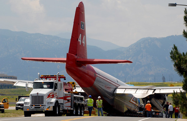 """The P2 Neptune air tanker at Rocky Mountain Metropolitan Airport Saturday  that crashed Saturday afternoon was moved off of 120th St. back through the hole in the fence into the tanker area.<br /> For a video of the tanker being moved, go to  <a href=""""http://www.dailycamera.com"""">http://www.dailycamera.com</a>.<br />  Cliff Grassmick / June 27, 2010"""