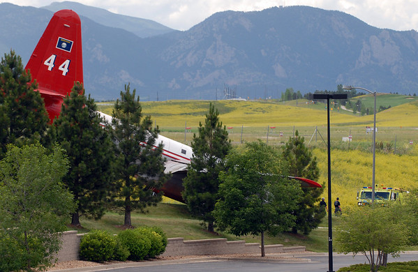 This air tanker came to a stop on 120th Street after going off the runway.<br /> The crash of an air tanker at Rocky Mountain Metropolitan Airport Saturday afternoon has prompted officials to shut down its slurry resupply operation at the Broomfield airport for at least the rest of the day, a decision that could hamper efforts to battle an 800-acre wildfire in Rocky Mountain National Park.<br /> Cliff Grassmick / June 26, 2010
