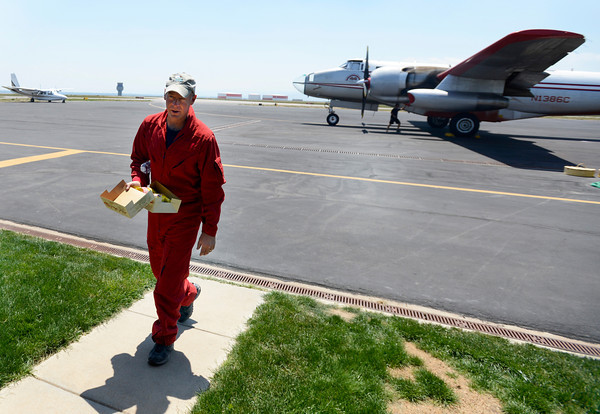 An air tanker pilot walks off the flight line to take a rest as crews work to refill fire retardant into an air tanker that is fighting the High Park fire on Monday, June 11, at the Rocky Mountain Metropolitan Airport in Broomfield.<br /> Jeremy Papasso/ Camera