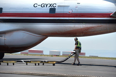 Crews work to refill fire retardant into an air tanker that is fighting the High Park fire on Monday, June 11, at the Rocky Mountain Metropolitan Airport in Broomfield. Jeremy Papasso/ Camera