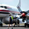 Ramp Manager Matt Nykanen, front, walks onto the flight line while crews work to refill fire retardant into an air tanker that is fighting the High Park fire on Monday, June 11, at the Rocky Mountain Metropolitan Airport in Broomfield.<br /> Jeremy Papasso/ Camera