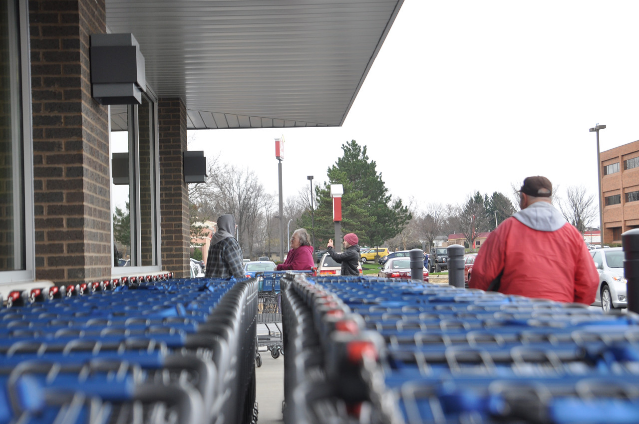 ASHLEY FOX / GAZETTE A customer takes pictures of the long line at the Grand Opening of ALDI in Wadsworth.