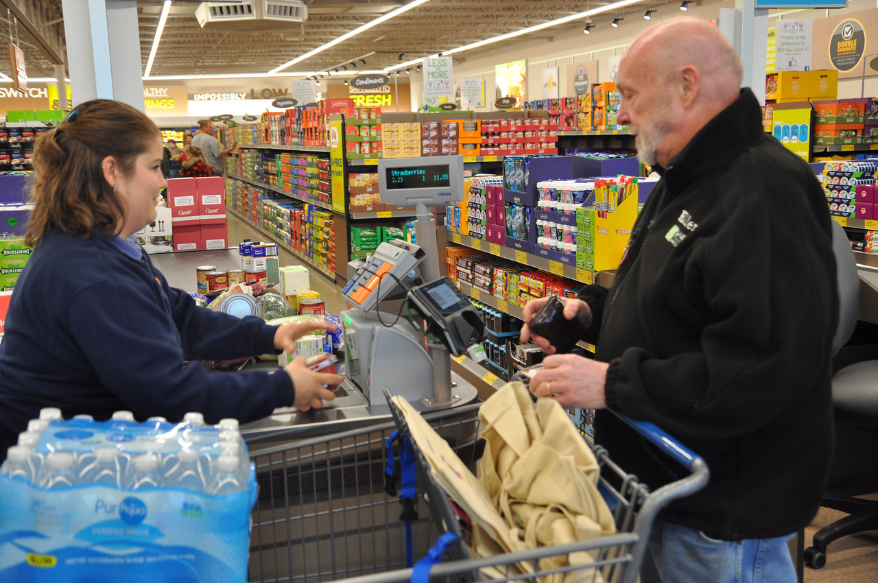 ASHLEY FOX / GAZETTE Ellery Patterson of Wadsworth, was first in line on Thursday for the Grand Opening of ALDI, arriving at 5:30 a.m. Due to the amount of customers, officials opened the doors at 8:30. Patterson filled his cart and proceeded to check out by 8:48 a.m.
