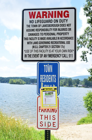 GILLIAN JONES — THE BERKSHIRE EAGLE<br /> A few signs, including this one at the end of Sunrise Street in Lanesborough warned visitors of a possible algae bloom which prompted health officials to close Pontoosuc Lake on Friday. Officials lifted the advisory Monday afternoon after tests for cyanobacteria bloom where completed.