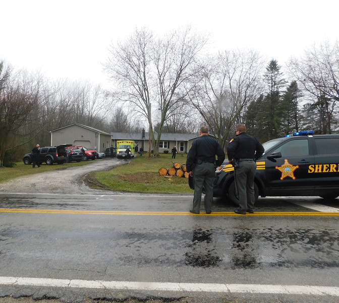 NATHAN HAVENNER / GAZETTE Sheriff's deputies respond to an accident involving another deputy in Westfield Township at a residence in the 10000 block of Friendsville Road.
