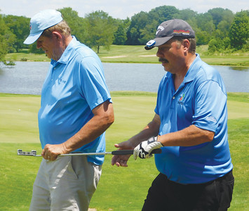 JONATHAN DELOZIER / GAZETTE Marshall Glenn guides Ron Derry of Columbus, right, on the fairway Wednesday in this year's American Blind Golf Championship, held at Hawk's Nest Golf Club in Creston.