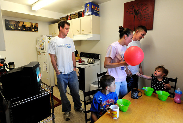 "University of Colorado student Jonathan Wezner, left, his wife Amber, brother Matt Wezner and his children Ayden, 7, front left, and Ashlyn, 2, getting ready for the day on Wednesday, April 18, in Boulder. For more photos and video of the life of Wezner go to  <a href=""http://www.dailycamera.com"">http://www.dailycamera.com</a><br /> Jeremy Papasso/ Camera"