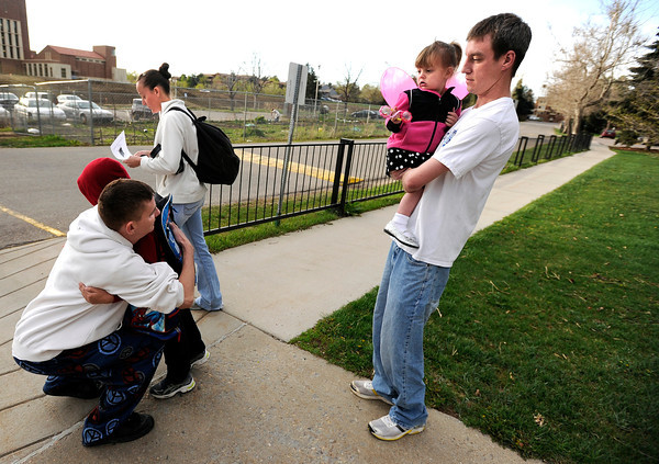 "University of Colorado student Jonathan Wezner, right, holds his daughter Ashlyn, 2, as he watches his brother Matt Wezner hug Ayden, 7, before getting on the school bus on Wednesday, April 18, in Boulder. For more photos and video of the life of Wezner go to  <a href=""http://www.dailycamera.com"">http://www.dailycamera.com</a><br /> Jeremy Papasso/ Camera"
