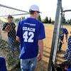 "University of Colorado student Jonathan Wezner walks onto the field at the start of a tee-ball game on Wednesday, April 18, in Boulder. Wezner and his wife Amber coach the team that their son Ayden plays for. For more photos and video of the life of Wezner go to  <a href=""http://www.dailycamera.com"">http://www.dailycamera.com</a><br /> Jeremy Papasso/ Camera"
