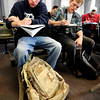 "University of Colorado student and Army veteran Jonathan Wezner, left, and freshman John Cronk, right, take notes in Micro-economics class on Wednesday, April 18, in Boulder. For more photos and video of the life of Wezner go to  <a href=""http://www.dailycamera.com"">http://www.dailycamera.com</a><br /> Jeremy Papasso/ Camera"