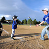 "University of Colorado student and Army veteran Jonathan Wezner tosses a ball to Darby Kropp, 6, on Wednesday, April 18, during a tee-ball game at Eisenhower Elementary School in Boulder. Wezner and his wife Amber are the coaches for the Dodgers team. For more photos and video of the life of Wezner go to  <a href=""http://www.dailycamera.com"">http://www.dailycamera.com</a><br /> Jeremy Papasso/ Camera"
