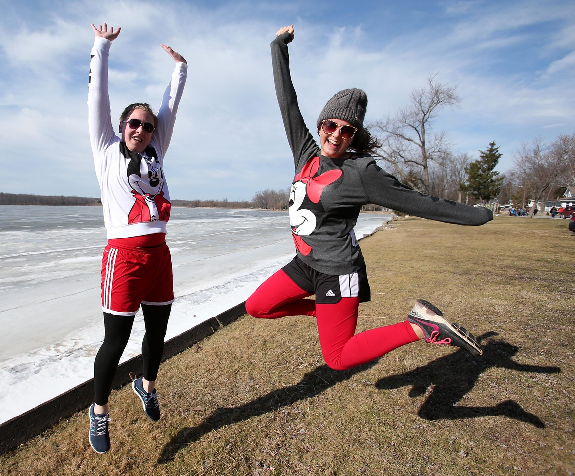 AARON JOSEFCZYK / GAZETTE  Kelsey Lattimore and Jessica Vargo get ready for their jump into Chippewa Lake on Saturday at the 2016 Polar Bear Jump fund-raising event.