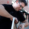 "Andrew Kurcan leaves his art hanging around  various location in downtown Boulder on Saturday March 31, 2012. Kurcan is doing an art project called ""Photo Grafitti/Boulder is My Gallery,"" <br /> For a video of the Andrew Kurcan hanging art around Boulder  <a href=""http://www.dailycamera.com"">http://www.dailycamera.com</a><br /> Photo by Derek Broussard"
