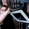 """Andrew Kurcan leaves his art hanging around  various location in downtown Boulder on Saturday March 31, 2012. Kurcan is doing an art project called """"Photo Grafitti/Boulder is My Gallery,"""" <br /> For a video of the Andrew Kurcan hanging art around Boulder  <a href=""""http://www.dailycamera.com"""">http://www.dailycamera.com</a><br /> Photo by Derek Broussard"""