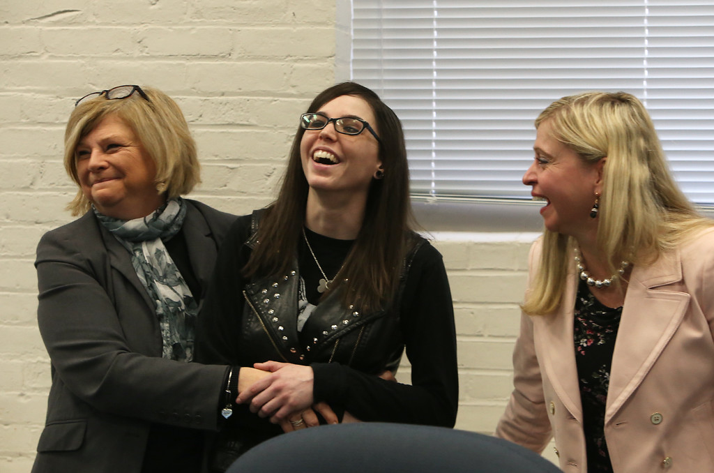 . Talking after forum on school bullying and suicide, from left, Samaritans of Merrimack Valley director Debbie Helms, suicide attempt survivor Caitlin Caruso, who know Helms from working with the Samaritans, and mental health counselor Denise Peaslee.  (SUN/Julia Malakie)