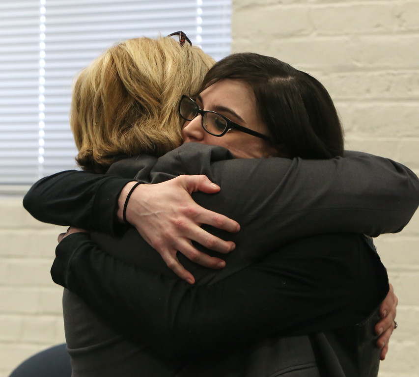 . After livestreamed forum on school bullying and suicide with, Samaritans of Merrimack Valley director Debbie Helms, left, hugs suicide attempt survivor Caitlin Caruso, who know Helms from working with the Samaritans.  (SUN/Julia Malakie)