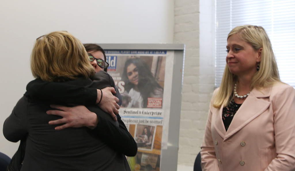 . After livestreamed forum on school bullying and suicide with, Samaritans of Merrimack Valley director Debbie Helms, left, hugs suicide attempt survivor Caitlin Caruso, who know Helms from working with the Samaritans. At right is mental health counselor Denise Peaslee.  (SUN/Julia Malakie)