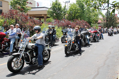 ALEC SMITH / GAZETTE Hundreds of motorcyclists participate Sunday in an event called Cops Ride, in which riders traveled about 54 miles through Cuyahoga, Lorain and Medina counties. The event ended at Stinger Harley-Davidson in Medina Township.