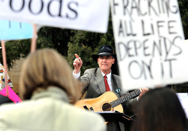 "Michael Bellmont, of Longmont, center, points to the crowd while singing a song about fracking during an anti-fracking rally on Monday, April 16, at the Boulder County Courthouse on Pearl Street in Boulder. For more photos and video about fracking in Boulder County go to  <a href=""http://www.dailycamera.com"">http://www.dailycamera.com</a><br /> Jeremy Papasso/ Camera"