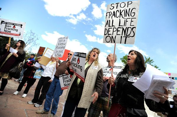 "Norma Groverland, of Boulder, right, and Kini Christie, of Lafayette, center, participate in a sing along during an anti-fracking rally on Monday, April 16, at the Boulder County Courthouse on Pearl Street in Boulder. For a video about fracking in Boulder County go to  <a href=""http://www.dailycamera.com"">http://www.dailycamera.com</a><br /> Jeremy Papasso/ Camera"