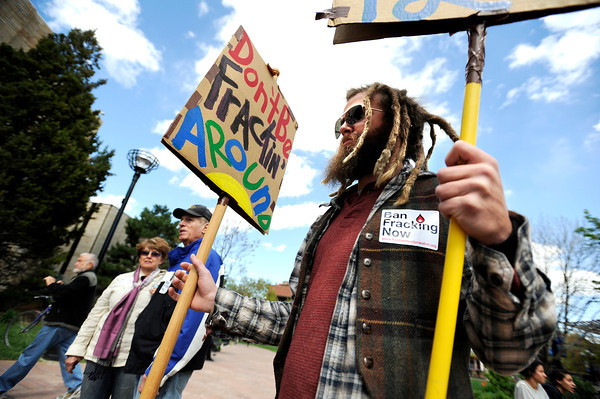 "Zack Delashmit, of Nederland, holds his anti-fracking signs during an anti-fracking rally on Monday, April 16, at the Boulder County Courthouse on Pearl Street in Boulder. For a video about fracking in Boulder County go to  <a href=""http://www.dailycamera.com"">http://www.dailycamera.com</a><br /> Jeremy Papasso/ Camera"