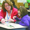 Volunteer Lisa Kuhn reads with Stokes third-grader Jacklynn Irwin during ReadUP after school Thursday afternoon.