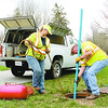 Dora Roberts and Jim Rawlings of Wessler Engineering set up a smoke test in the Elmwood subdivision Wednesday.