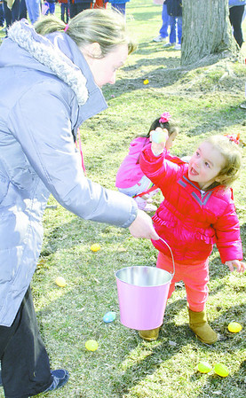 Lyla Suson, 2, shows mom Holly one of her discoveries during Saturday's Easter egg hunt at Lebanon's Memorial Park.