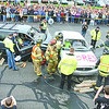 Emergency responders work on the scene of a mock car crash Thursday afternoon on the Lebanon Middle School campus. The crash was part of the Every 15 Minutes program, which showcases the dangers of drunk driving.